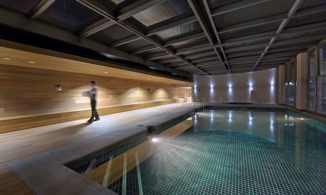 Hotel Pool - Indoor heated roof top pool at night with beautiful lighting